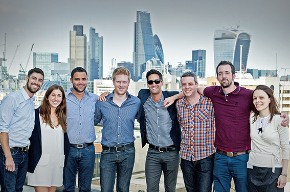 Group photo with City skyline backdrop London