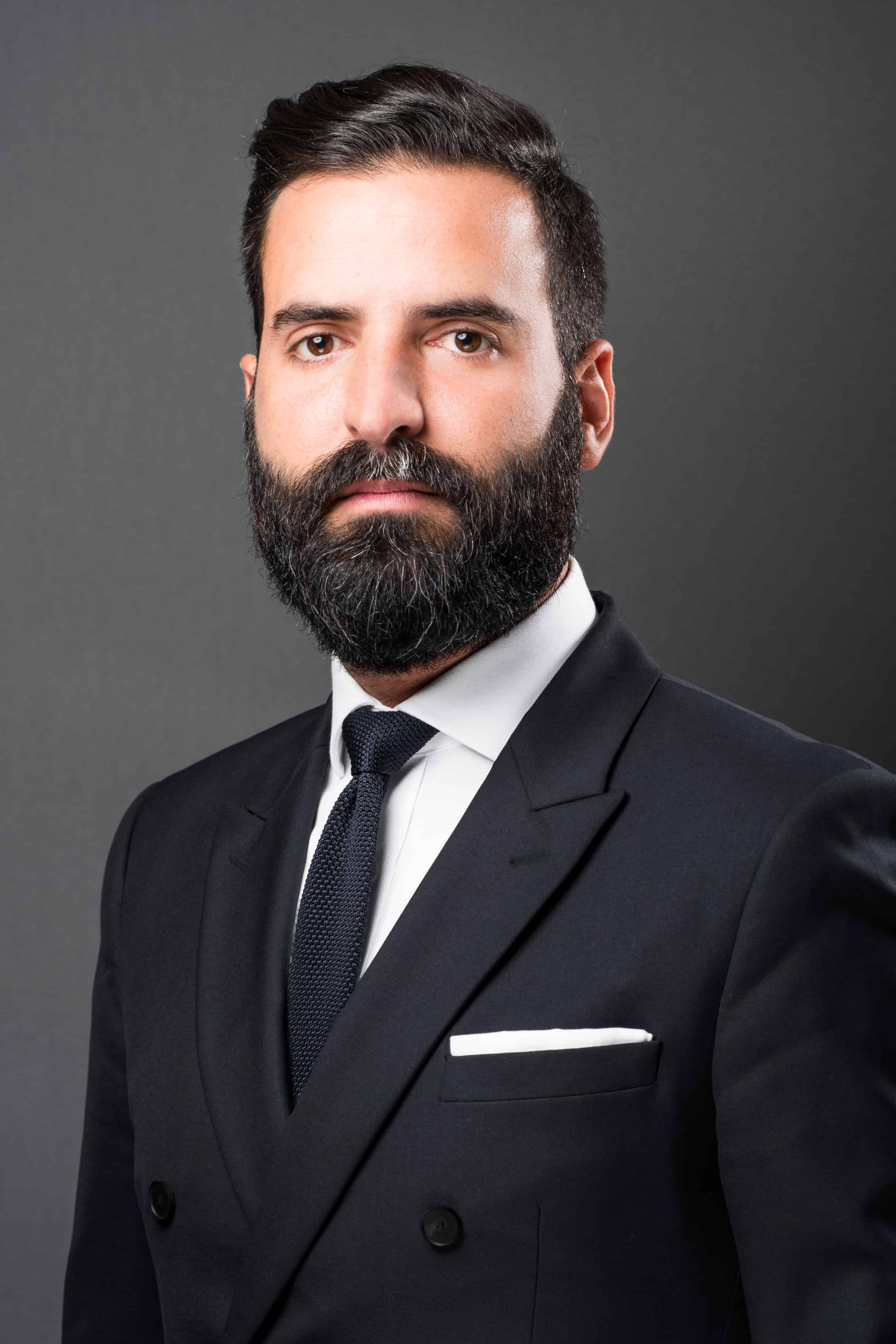 Corporate headshot of businessman with formal dress.