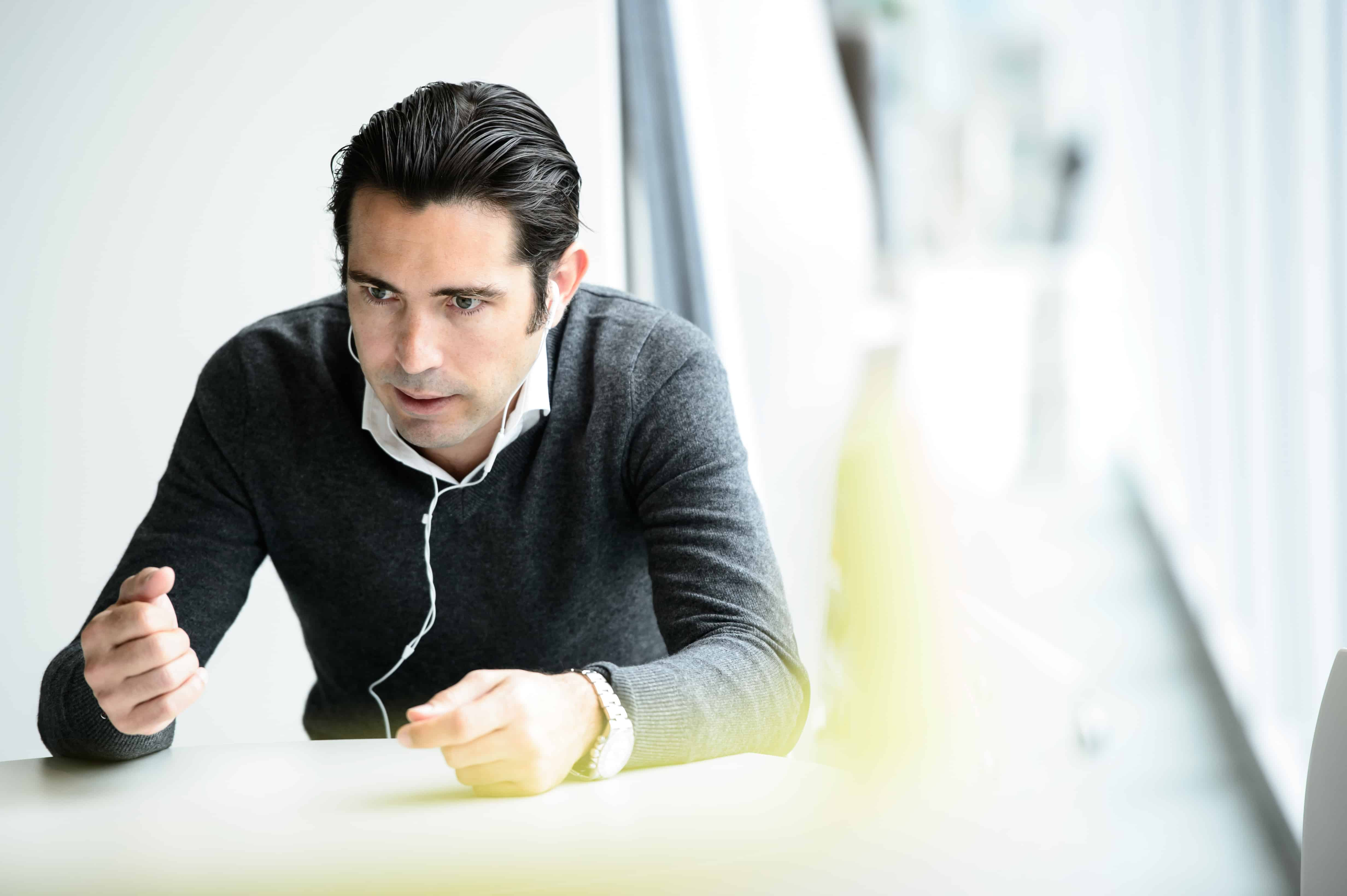 Reportage corporate photograph of businessman working