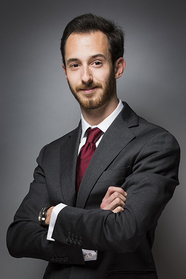 LinkedIn corporate headshot with dark black background
